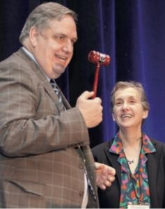 Ken Mack receives traditional CNS President's gavel in 2015 from his predecessor, Nina Schor